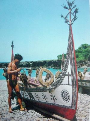 pêcheur et sa barque décorée